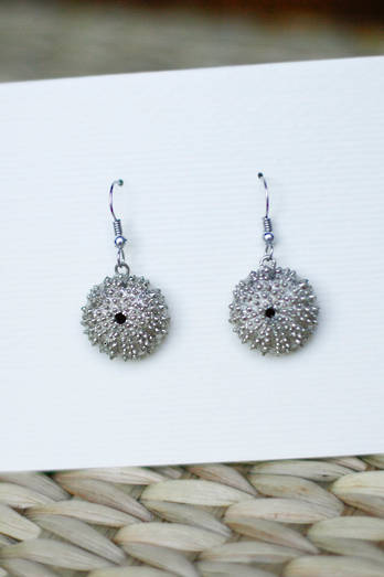 White bronze kina earrings